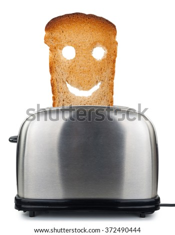 Happy toast in a toaster - stock photo