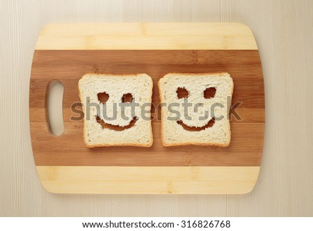 Happy toast  on a cutting board - stock photo