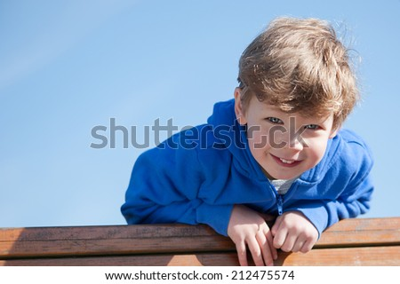 Happy toddler boy looking down to camera. - stock photo