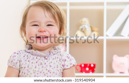 Happy toddler girl with a cheerful smile - stock photo