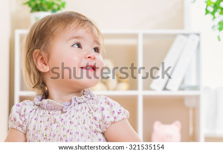 Happy toddler girl with a giant smile - stock photo