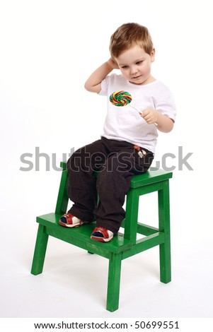happy toddler with big lollipop - stock photo