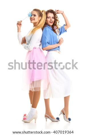 Happy together concept. two pretty girls smiling on a white background . Vintage style. Fashion photo. studio photo . White background. smiling face - stock photo
