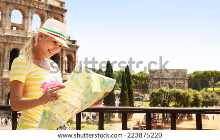 Happy Tourist and Coliseum, Rome. Cheerful Young Blonde Woman with Map in Italy. Travel in Europe - stock photo