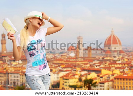 Happy Tourist in Florence. Cheerful Young Blonde Woman with Map over Cathedral of Santa Maria del Fiore (Duomo). Travel in Italy. Europe - stock photo