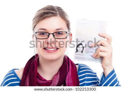 Happy tourist traveller woman showing passport, isolated on white background. - stock photo