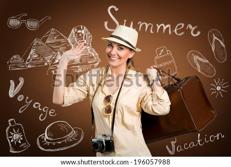 Happy tourist with hand drawn thinks for traveling  - stock photo
