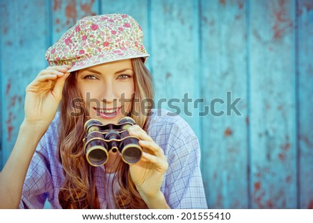Happy tourist woman with retro binoculars enjoy her journey. Happy vacation concept. focus on face - stock photo