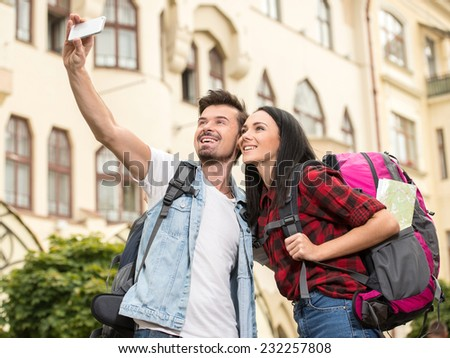 Happy tourists are taking photo of themselves in the town. - stock photo