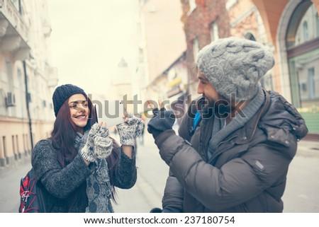 Happy Tourists Couple Enjoying The City And Taking Photo - stock photo