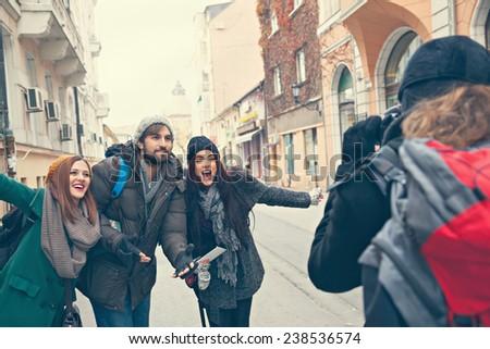 Happy Tourists Enjoying The City And Taking Photo - stock photo