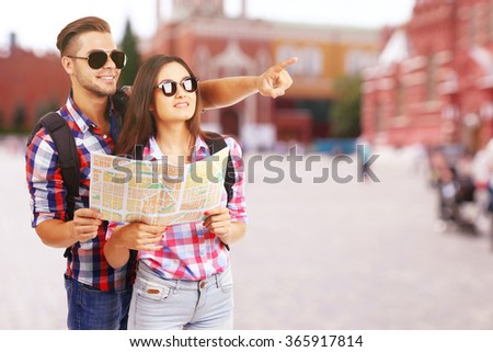 Happy tourists on street in city - stock photo
