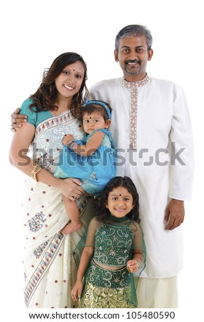 Happy traditional Indian family in traditional Indian costume standing on white background