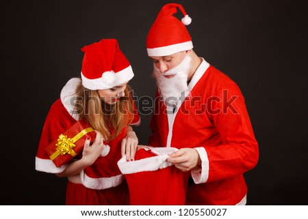 Happy traditional Santa Claus and girl