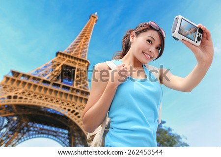 Happy travel woman in Paris with Eiffel Tower and she take a selfie picture, asian beauty - stock photo
