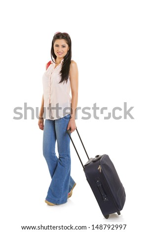 Happy traveling businesswoman carrying travel suitcase isolated on white background.