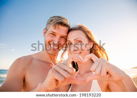 happy traveling couple summertime beach - stock photo
