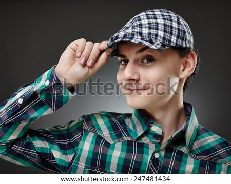 Happy trendy handsome teenage boy in hat, studio closeup - stock photo