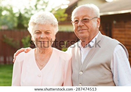 Happy trendy retired senior couple posing