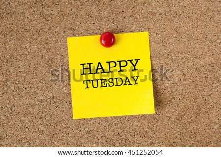 Happy tuesday word with yellow reminder sticky note on cork board - stock photo