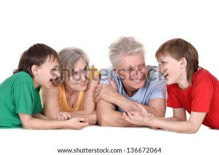 happy two boys and their grandparents lying on the floor