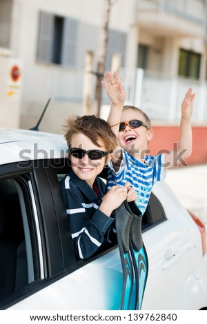 Happy two brothers excited for the vacation holidays - stock photo