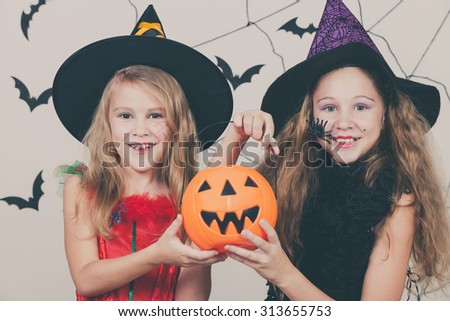 Happy  two sisters on Halloween party