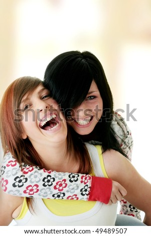 Happy two teen sisters at home - stock photo
