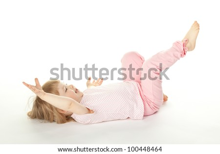 Happy two years old girl having fun on the floor; white background - stock photo