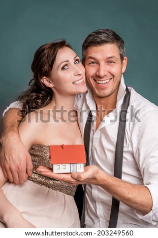 happy two younger peoplebuying home - stock photo