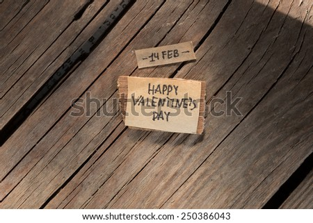 Happy Valentine's Day Hand Lettering, label on a wooden table