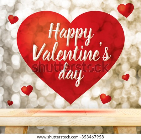 Happy Valentine's day in red heart floating above wood table at gold blur bokeh, Love concept - stock photo