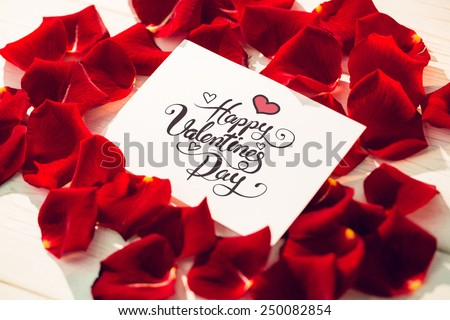 Happy valentines day against card surrounded by rose petals - stock photo