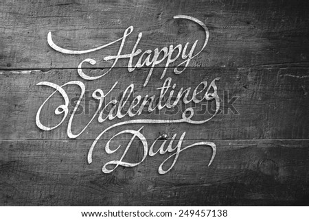 Happy valentines day against overhead of wooden planks - stock photo
