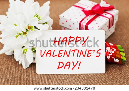 Happy Valentines Day card with a gift box and flowers - stock photo