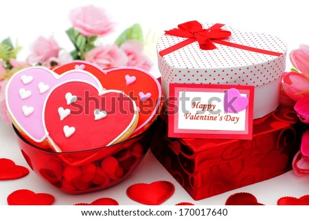 Happy Valentines Day card with gifts and bowl of cookies