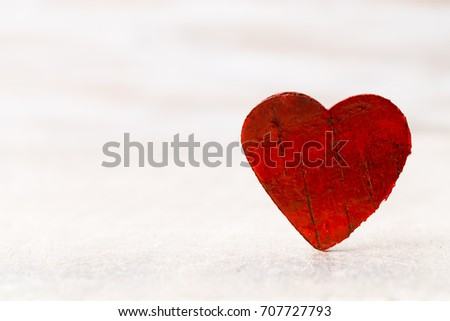 Happy Valentines Day. Red Heart on a wooden background.