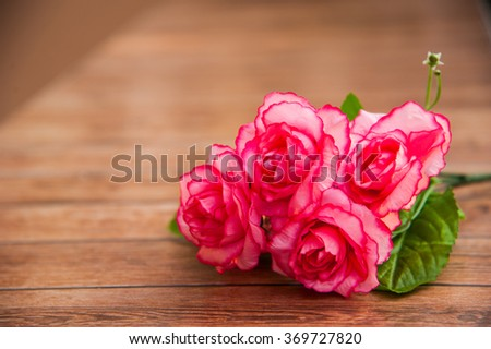 Happy Valentines Day, Special day, Birthday, Anniversary. Roses on wood background and right of frame.Bouquet for special person. - stock photo