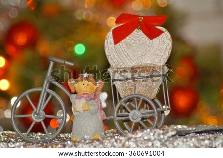 Happy Valentines day - Valentine's decorations, angel on a bicycle and heart - stock photo