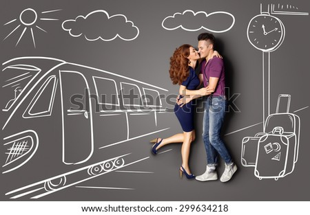 Happy valentines love story concept of a romantic couple against chalk drawings background of a railway station. Male meeting his girlfriend at the station and kissing her under a street clock. - stock photo