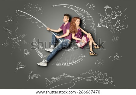 Happy valentines love story concept of a romantic couple fishing on a moon with a star on a hook against chalk drawings background of a night sky and a Cupid. - stock photo