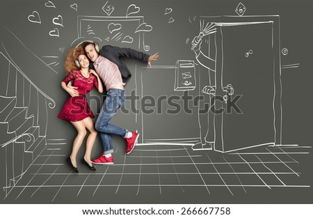 Happy valentines love story concept of a romantic couple sharing headphones and listening to the music on the stairs too loud for neighbors, against chalk drawings background. - stock photo