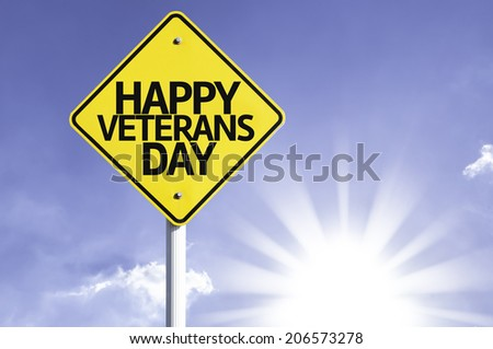 Happy Veterans Day road sign with sun background  - stock photo