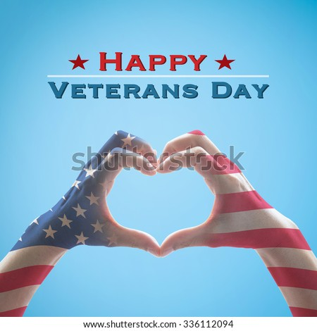 Happy Veterans day text message with American flag pattern on people hands in heart shape form isolated on bright blue sky background: United states of america- USA national holiday concept  - stock photo
