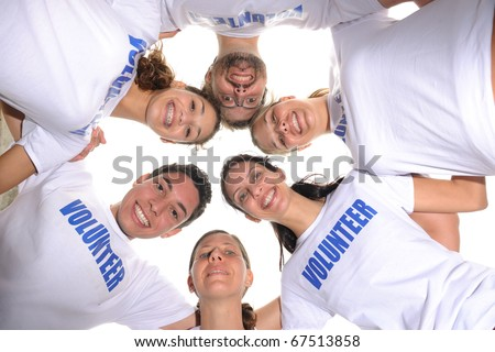 Happy volunteer group forming a circle - stock photo