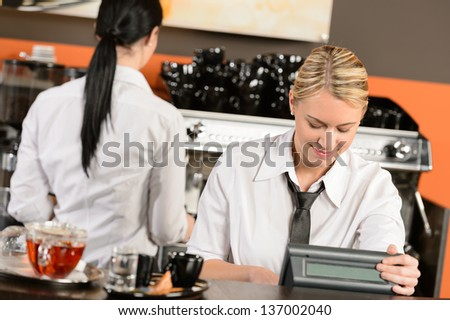 Happy waitresses working at cafe in uniform - stock photo