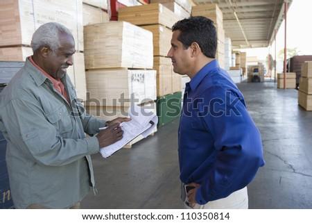 Happy warehouse workers - stock photo