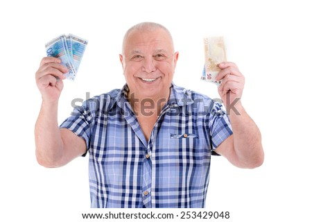 Happy wealthy old guy man, successful people business man holding millions euro money banknotes in hands for selling tickets. Isolated white. Positive human emotion, facial expression feeling fortune. - stock photo