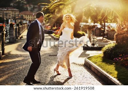 happy wedding couple in Como Lake, Italy - stock photo