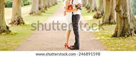 Happy wedding couple walking in  park. - stock photo